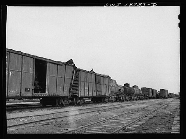 Topeka, Kansas. Wrecked freight cars which will be rebuilt at the Atchison, Topeka and Santa Fe Railroad car shops