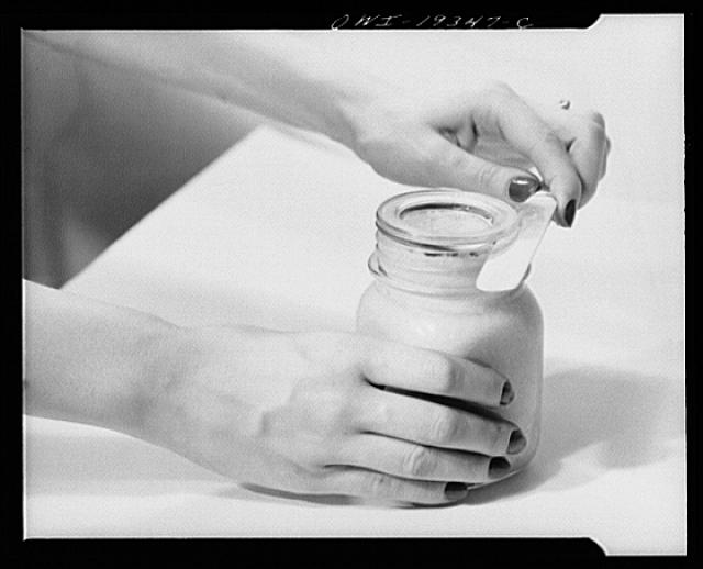 Steel-saving glass-top jars recommended by the War Production Board, Containers Division, for home canning of the Victory garden fruits and vegetables in 1943. To open the jar, insert knife between glass lid and rubber ring