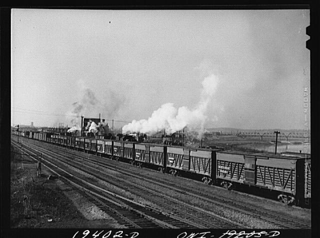 An Atchison, Topeka and Santa Fe Railway train carrying stock cars leaving for the east