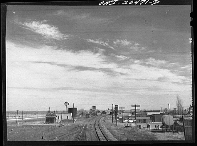 Fort Sumner (vicinity), New Mexico. Passing through a small town on the Atchison, Topeka and Santa Fe Railroad in the Pecos River Valley enroute to Vaughn, New Mexico