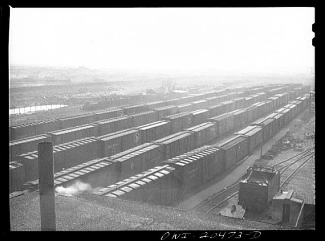 Sandstorm over a Atchison, Topeka and Santa Fe Railroad yard