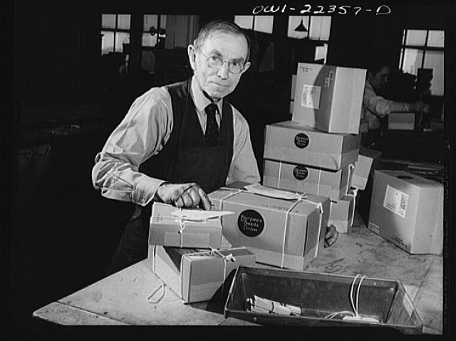Philadelphia, Pennsylvania. Wrapper with packages of seed ready for the mail at the W. Atlee Burpee Company, seed dealers