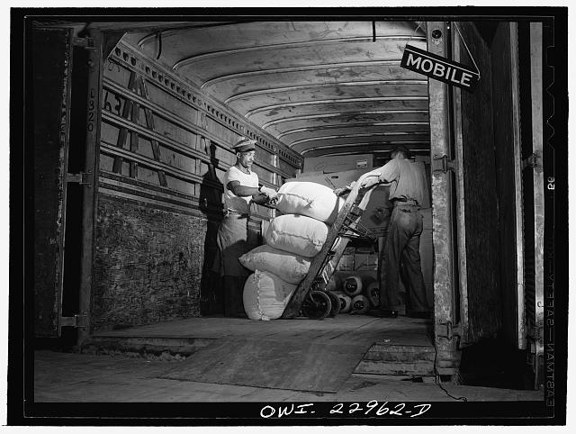 New Orleans, Louisiana. Loading a truck bound for Mobile at the Associated Transport Company