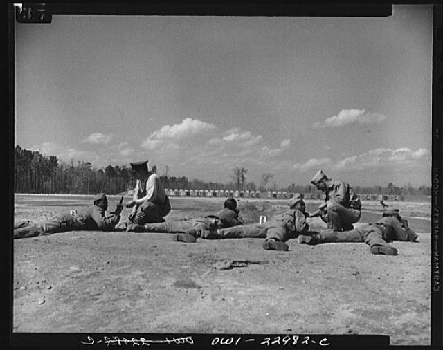 Camp Lejeune, New River, North Carolina. Negro engineers of the 51st Composite Battalion, U.S. Marine Corps, learning to fire 30 calibre rifles