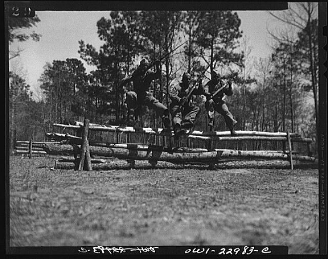 "Camp Lejeune, New River, North Carolina. Classes in bayonet training which are taught by Corporal Arvin L. Ghazlo. He also has charge of the ""commando"" and judo classes (at one time he taught judo to the state police of Georgia)"