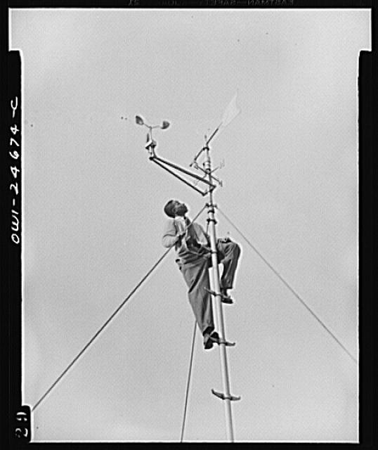 Benjamin Franklin High School, New York, New York. Victory Corps boy learning to use the school's weather vane in weather forecasting, as part of his pre-aeronautics training in meteorology