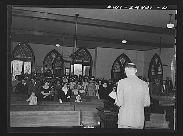 San Augustine, Texas. Congregation singing a hymn on Easter Sunday at the Methodist church