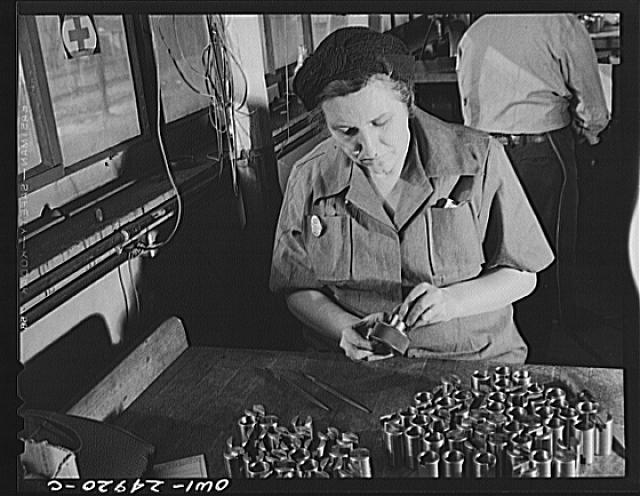 Milwaukee, Wisconsin. War production workers making M5 and M7 guns for the U.S. Army. Ex-housewife, age forty-six, checking small parts for a gun with steel gage. Her son is in the armed service