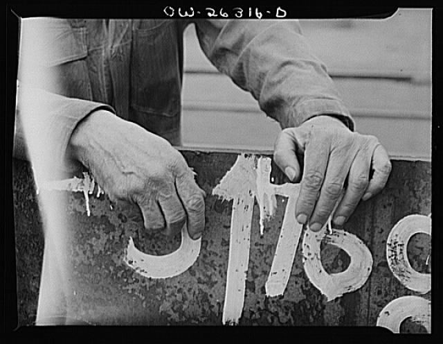 Bethlehem-Fairfield shipyards, Baltimore, Maryland. A shipyard worker's hands