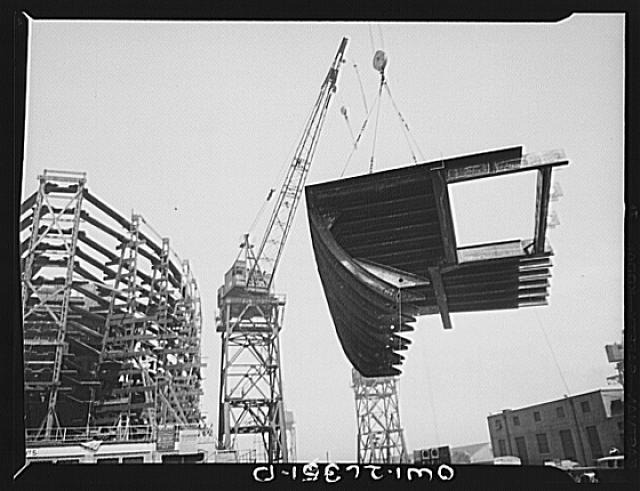 Bethlehem-Fairfield shipyards, Baltimore, Maryland. Lifting a ship section