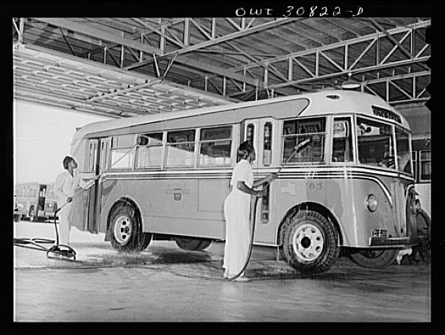 Beaumont, Texas. Women washing a bus at the city transit company