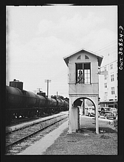 Beaumont, Texas. Lady in a railroad signal tower