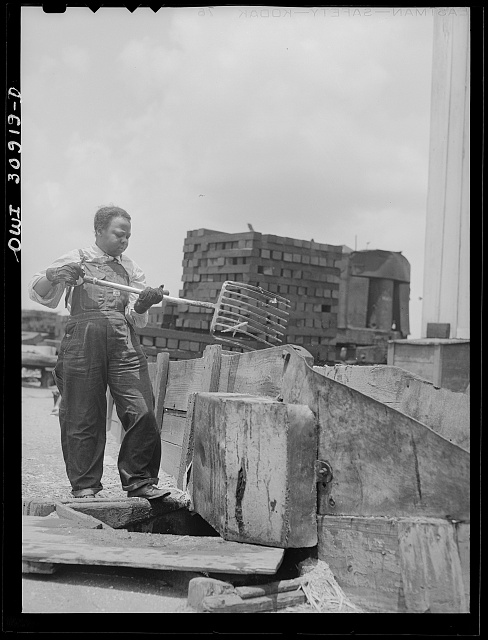Beaumont, Texas. Women worker at the International Cresoting plant. This work was formerly done by men