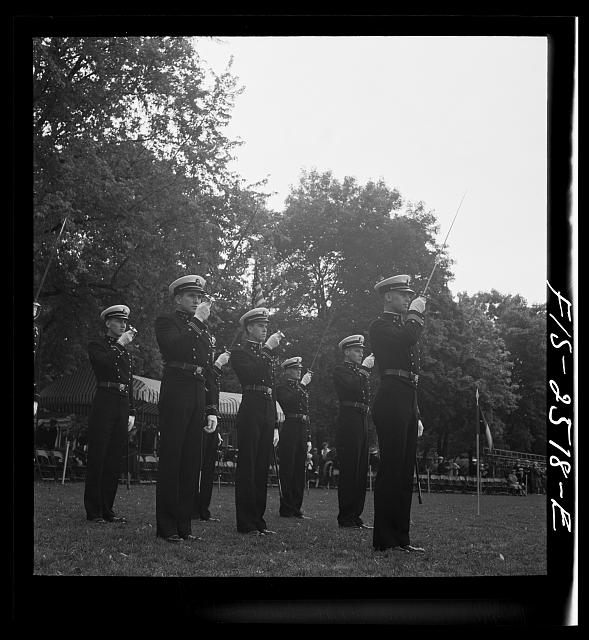 Annapolis, Maryland. Officers of the midshipmen's regiment, U.S. Naval Academy, giving their saber salute
