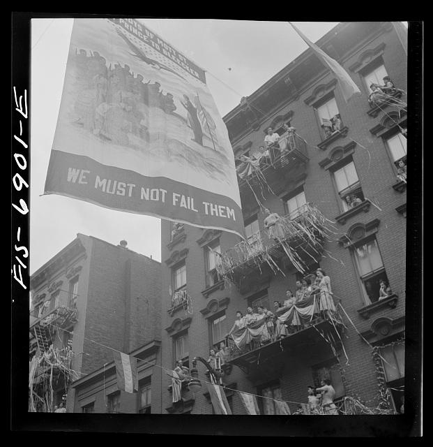 New York, New York. Flag raising ceremony in the rain in honor of Mott Street boys in the United States Army