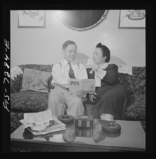 New York, New York. Mr. Fing, a Chinese-American merchant, and his wife in their Flatbush home. Notice the rubber tire ashtrays