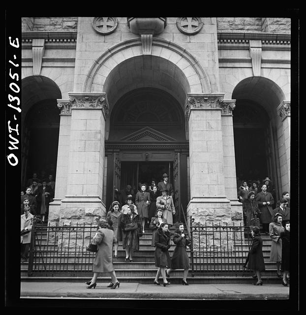 New York, New York. Italian-Americans coming out of Saint Dominick&#39;s church on Sullivan Street on New Year&#39;s Day