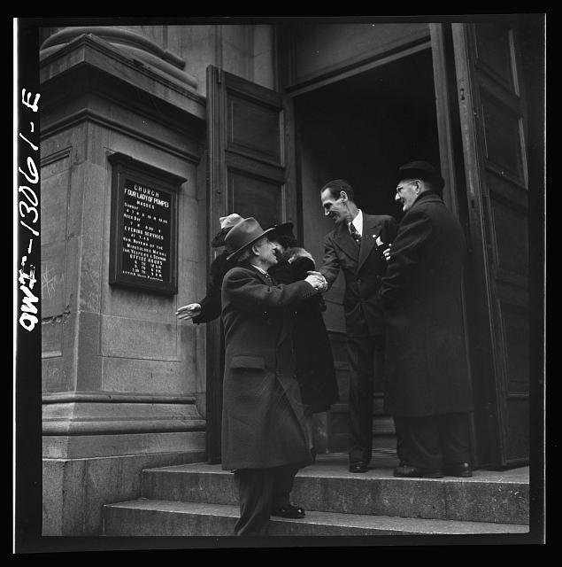 New York, New York. Italian-Americans leaving the church of Our Lady of Pompeii at Bleeker and Carmine Streets, on New Year's Day