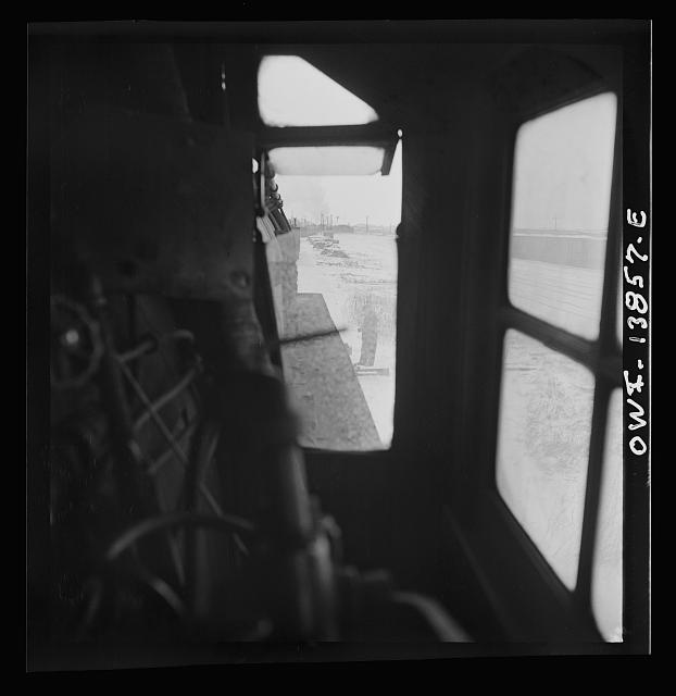 Freight operations on the Indiana Harbor Belt railroad between Chicago, Illinois and Hammond, Indiana. View through the window of the engineer's side of the cab. Ready to pull out of the yard, the engineer waits for the switchman to throw the switch