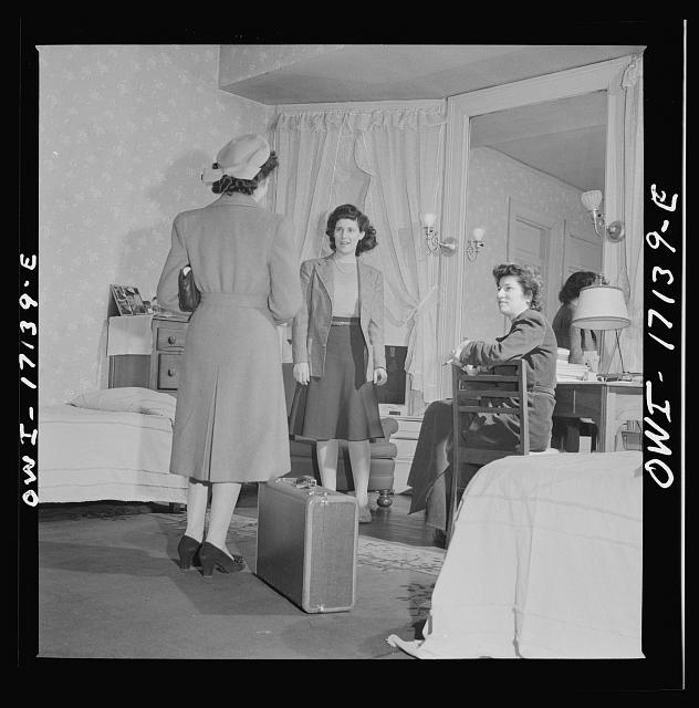 Washington, D.C. A girl employed by the U.S. government, a new arrival at a boardinghouse, being greeted by her roommates