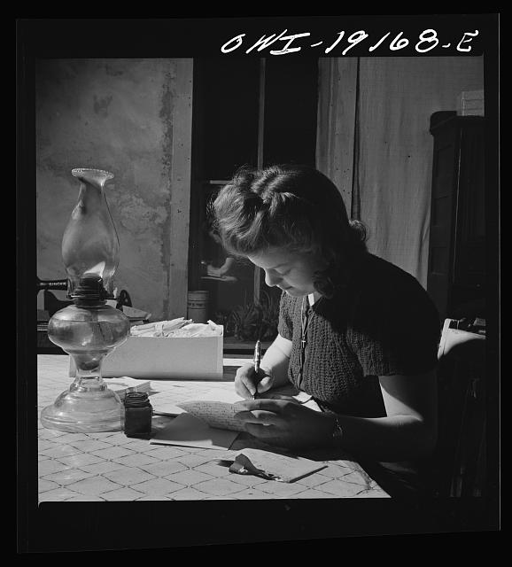 Moreno Valley, Colfax County, New Mexico. Mary Mutz on the ranch writing to a boyfriend in the United States Army