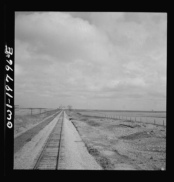 Emporia (vicinity), Kansas. Crossing farm land along the Atchison, Topeka, and Santa Fe Railroad