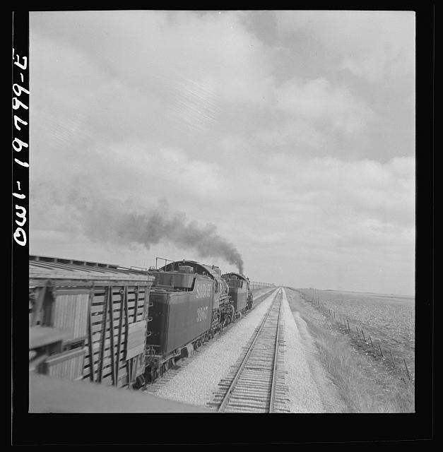 Emporia, Kansas. An Atchison, Topeka, and Santa Fe train between Argentine and Emporia, Kansas passing an eastbound freight train