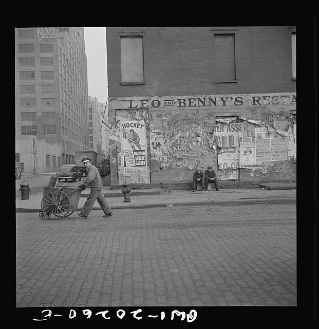 New York, New York. A street cleaner on Washington Street
