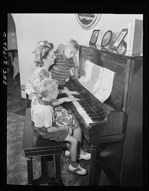 Rochester, New York. Howard and Earl Babcock enjoy singing to their mother's piano accompaniment