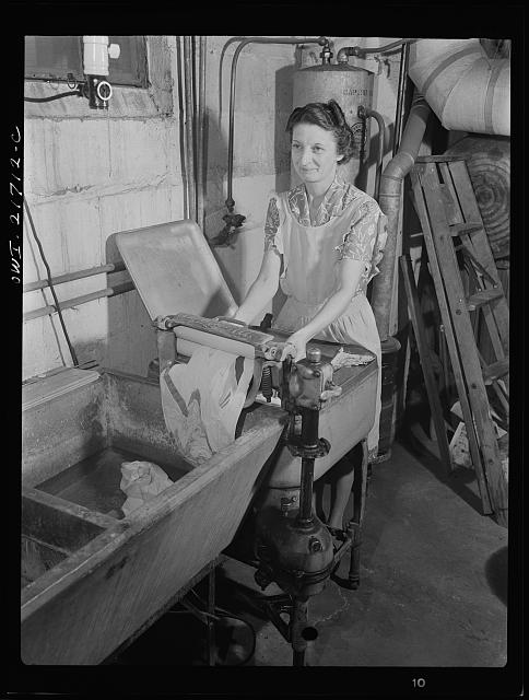Rochester, New York. Mrs. Babcock doing the family washing with an electric washing machine and a wringer