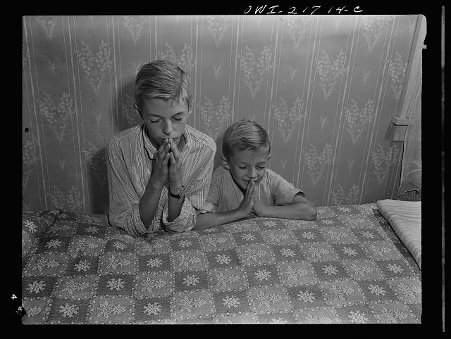Rochester, New York. Earl and Howard Babcock say their prayers every night before going to sleep