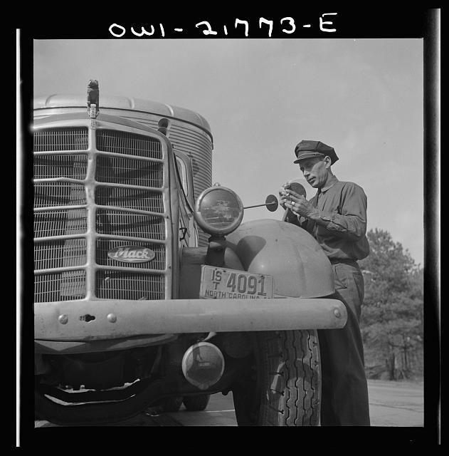 Joe Crow cleaning off the rear view mirror on his truck enroute to Montgomery, Alabama along U.S. Highway 29 in Georgia
