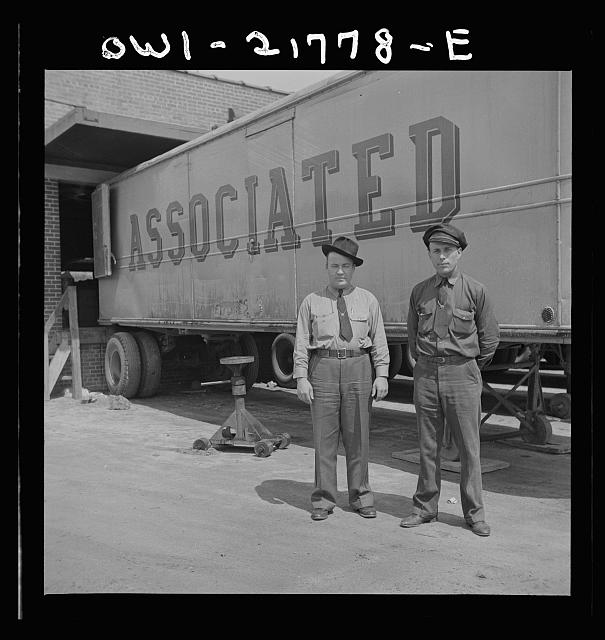 Atlanta, Georgia. Jim Bishop and Joe Crow, truck drivers for the Associated Transport Company terminal, before going out on the road