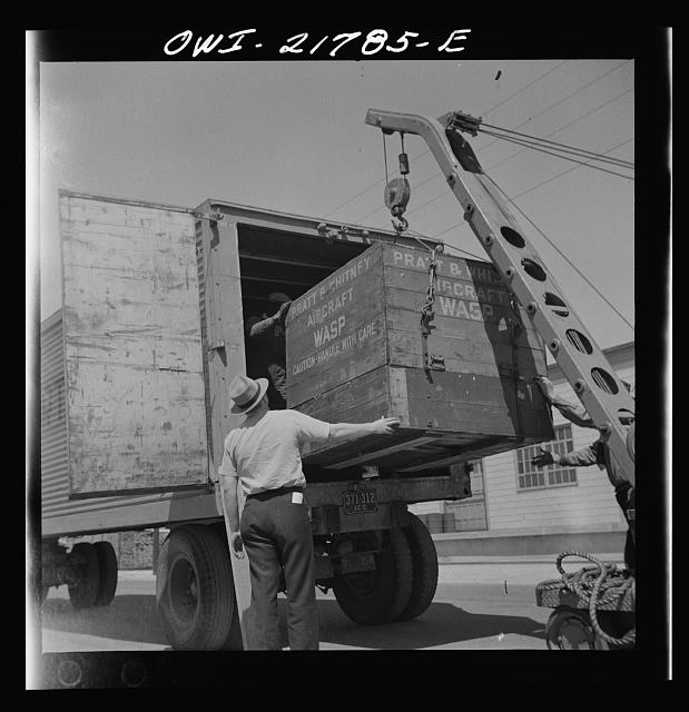 Gunter Field, Alabama. Loading airplane motors onto a truck. They are being shipped to Macon, Georgia for repairs