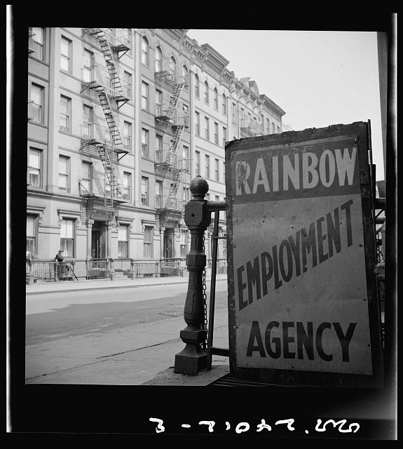 New York, New York. One of the numerous employment agency signs in the Harlem area