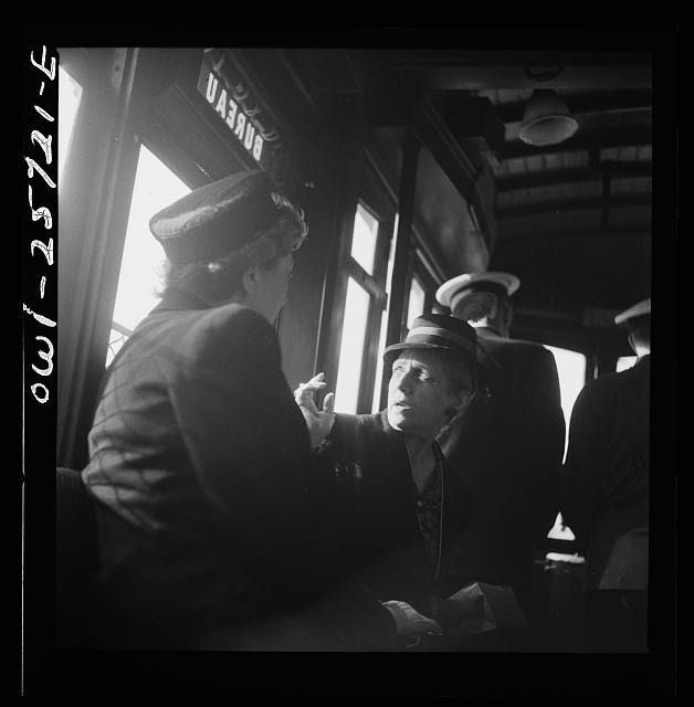 Arlington, Virginia. Women engaged in conversation on a street car