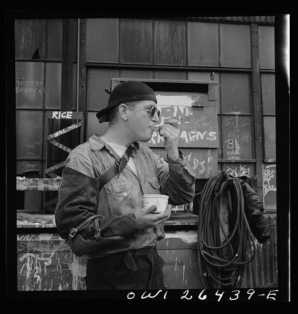 Bethlehem-Fairfield shipyards, Baltimore, Maryland. A welder eating ice cream