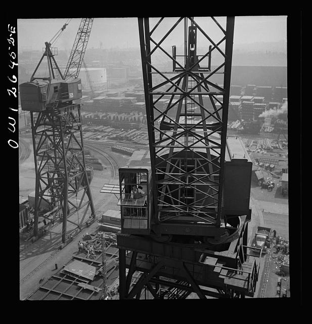 Bethlehem-Fairfield shipyards, Baltimore, Maryland. A crane operator high above the yard