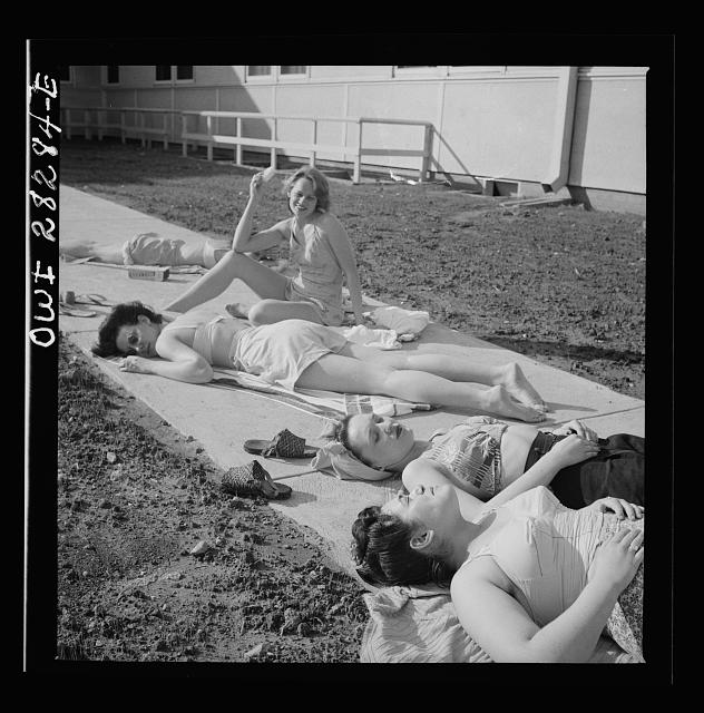 Arlington Farms, war duration residence halls. Sunbathers on the sidewalk in the back of Idaho Hall at Arlington Farms