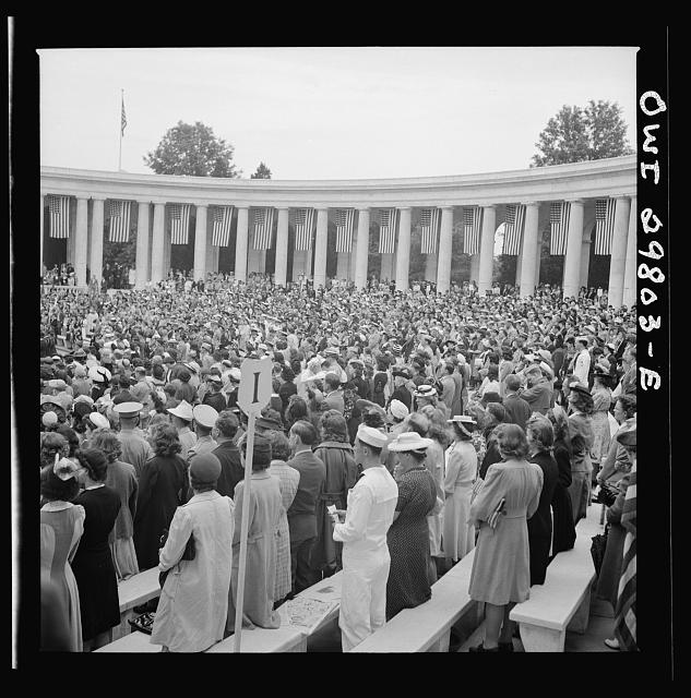 "Arlington Cemetery, Arlington, Virginia. Spectators rising to sing the ""Star Spangled Banner"" at the Memorial Day services in the amphitheater"