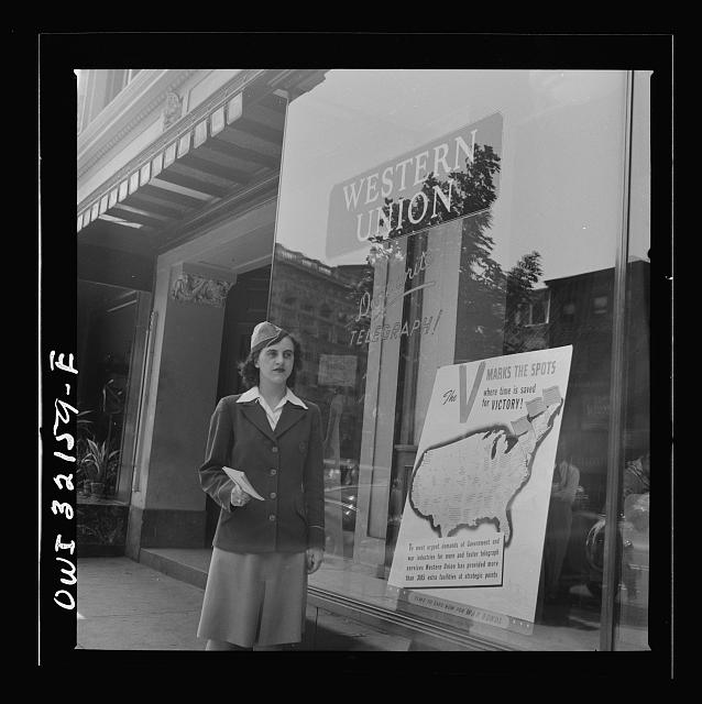 Washington, D.C. Miss Dorothy Lutz, a Western Union telegraph messenger, with telegrams