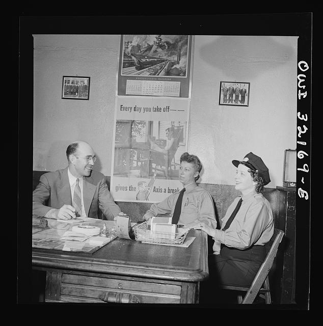 Washington, D.C. Women streetcar and bus operators Hattie B. Sheehan and Frances Lewis talking to Superintendent Henshaw of the Capitol Transit Company