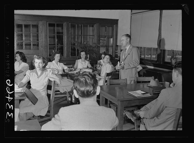Charlotte County, Virginia. Principal holding ten minutes teachers' meeting before classes in the morning, a regular routine
