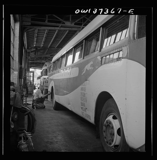 Columbus, Ohio. Working on a bus in the Greyhound garage