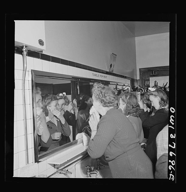 Chicago, Illinois. Passengers freshening up in the ladies' restroom at the Greyhound bus terminal