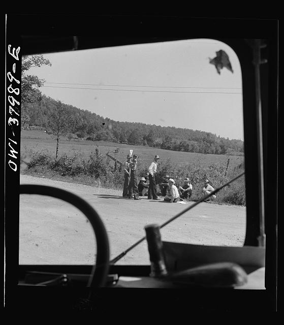 A Greyhound bus trip from Louisville, Kentucky, to Memphis, Tennessee, and the terminals. Men sitting by road side on Sunday afternoon, between Memphis and Chattanooga