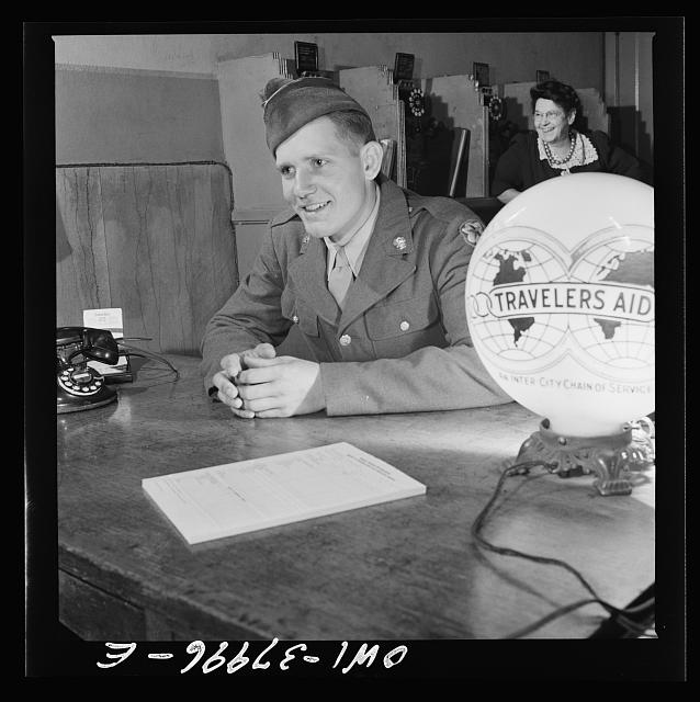 A Greyhound bus trip from Louisville, Kentucky, to Memphis, Tennessee, and the terminals. Serviceman getting information about a hotel at the traveler's aid desk in Memphis