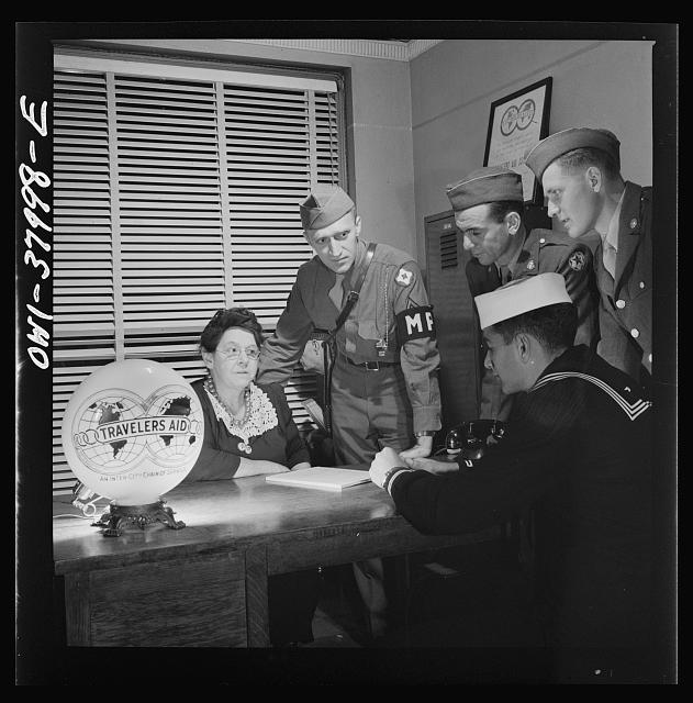 A Greyhound bus trip from Louisville, Kentucky, to Memphis, Tennessee, and the terminals. At travelers' aid desk in the bus terminal at Memphis, Tennessee. Servicemen ask for help in finding rooms, quickest route to get home, etc.
