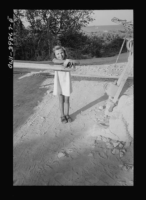 Small Sicilian girl, sister of the girl who tends the gates at the railroad crossing