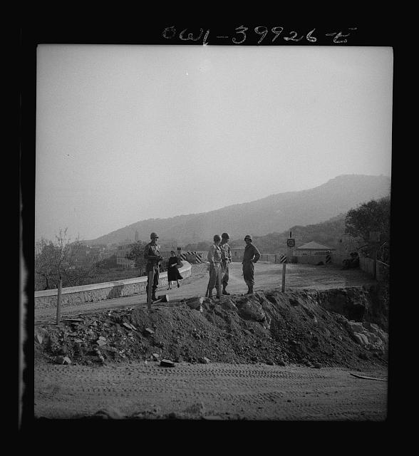 United States road builders in Sicily at a bridge blown up by the retreating Germans